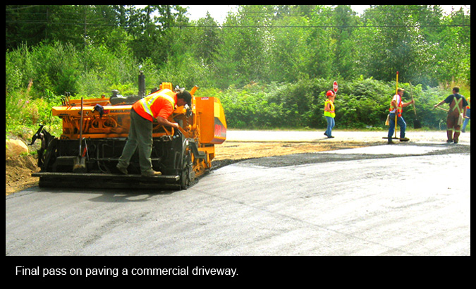 Final pass on paving a commercial driveway.