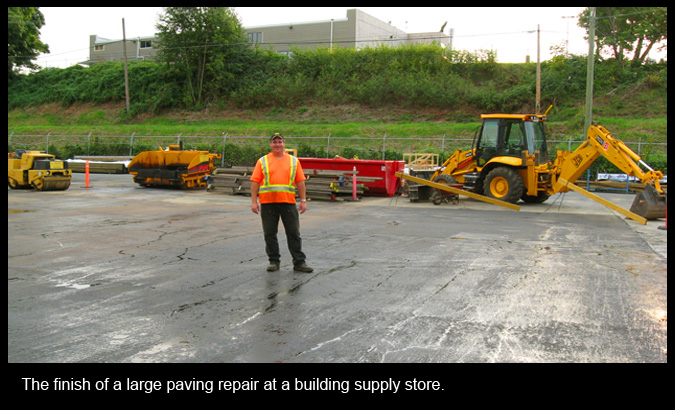 The finish of a large paving repair at a building supply store.